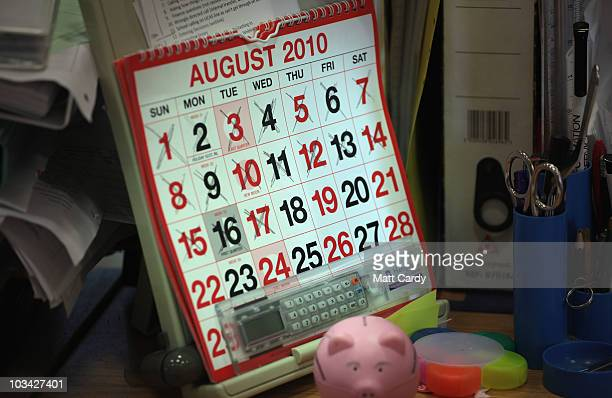A calender shows the days being crossed off for August as employees in the UCAS clearing house call centre answer telephone enquiries as they prepare...