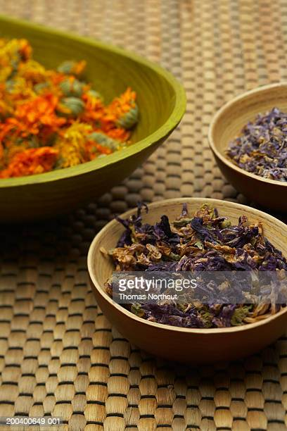 Calendula, calcatrippae and blue malva in wooden bowls, elevated view