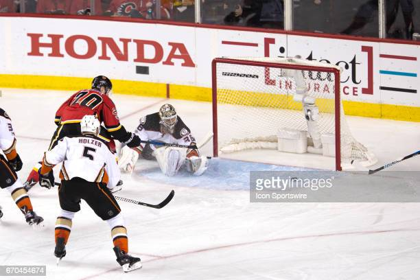 Calgary Flames Center Curtis Lazar narrowly misses the goal on Anaheim Ducks Goalie John Gibson during game 4 of the first round of the Stanley Cup...