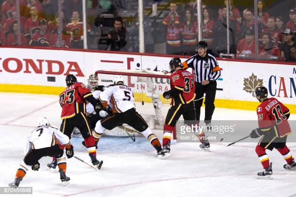 Calgary Flames Center Sean Monahan scores in the second period against Anaheim Ducks Goalie John Gibson during game 4 of the first round of the...