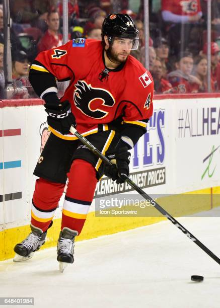 Calgary Flames Defenceman Matt Bartkowski skates with the puck during a game between the Calgary Flames and the New York Islanders on March 05 at the...