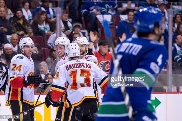 Calgary Flames Defenceman Travis Hamonic is congratulated after scoring a goal against the Vancouver Canucks during their NHL game at Rogers Arena on...