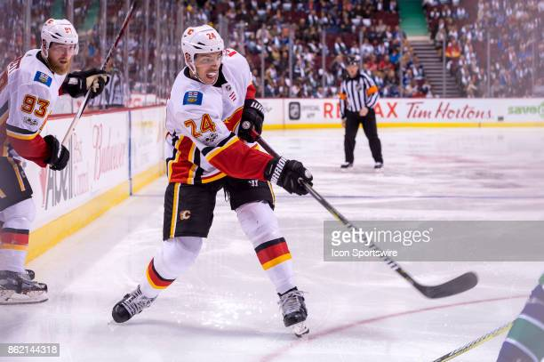 Calgary Flames Defenceman Travis Hamonic shoots the puck during their NHL game against the Vancouver Canucks at Rogers Arena on October 14 2017 in...