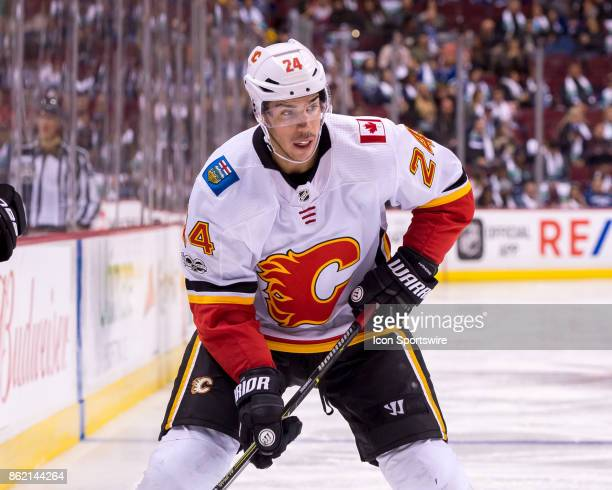 Calgary Flames Defenceman Travis Hamonic skates with the puck during their NHL game against the Vancouver Canucks at Rogers Arena on October 14 2017...