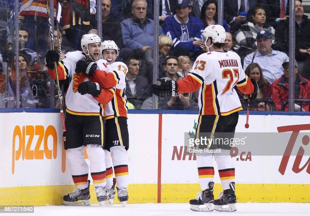 TORONTO ON DECEMBER 6 Calgary Flames defenseman Mark Giordano celebrates his first period goal with Calgary Flames left wing Johnny Gaudreau and...