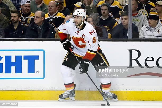 Calgary Flames defenseman Mark Giordano looks to pass during a regular season NHL game between the Boston Bruins and the Calgary Flames on November...