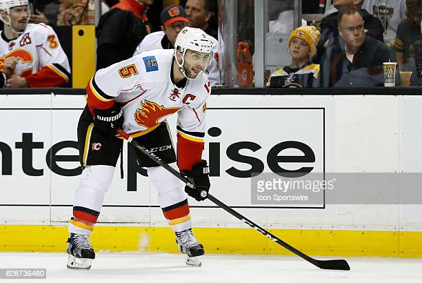Calgary Flames defenseman Mark Giordano waits at the point during a regular season NHL game between the Boston Bruins and the Calgary Flames on...