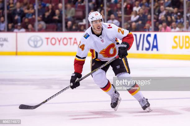 Calgary Flames defenseman Travis Hamonic skates in the offensive zone during their NHL preseason game against the Vancouver Canucks at Rogers Arena...