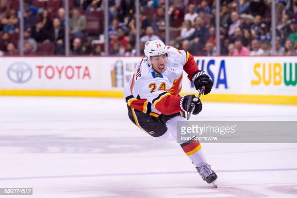 Calgary Flames defenseman Travis Hamonic takes a slap shot from the point during their NHL preseason game against the Vancouver Canucks at Rogers...