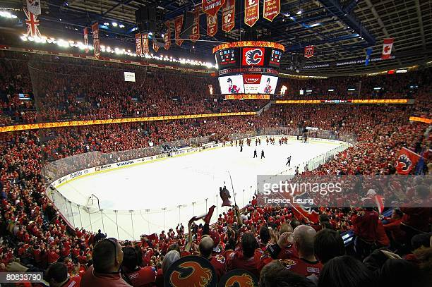 Calgary Flames fans in the 'C of Red' cheer for their team after time runs out on the clock during game six of the 2008 NHL Stanley Cup Playoffs...