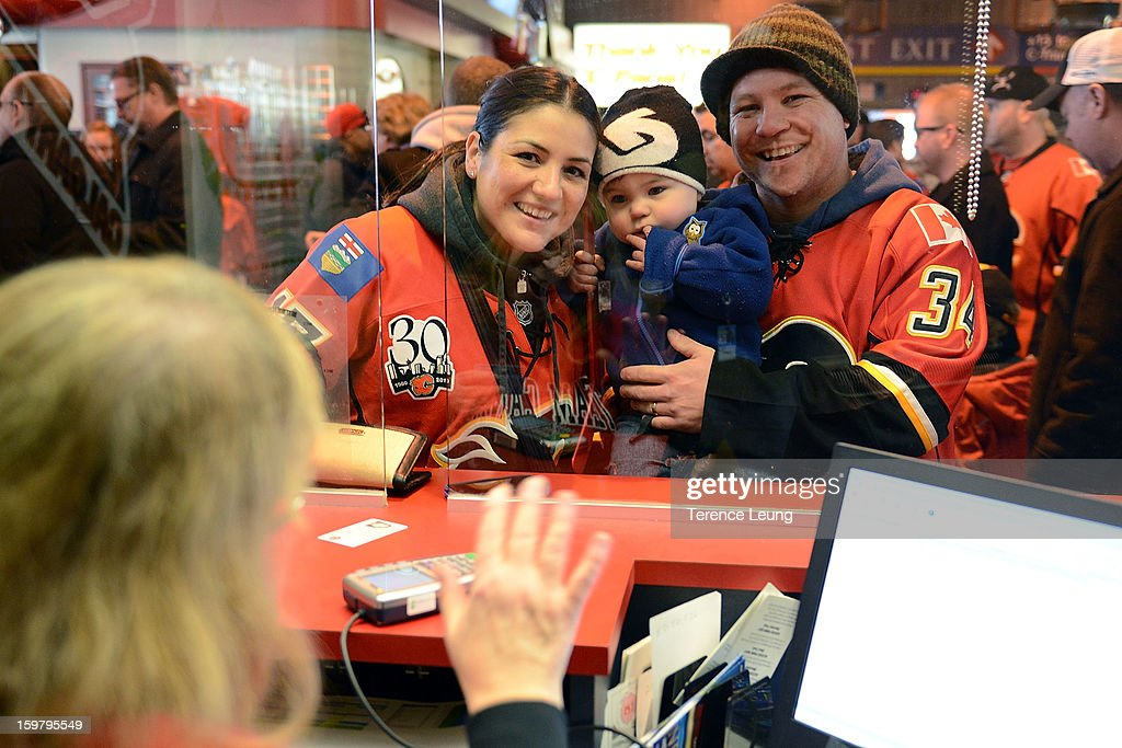 Calgary Flames fans pick up their tickets before the game against the San Jose Sharks on January 20, 2013 at the Scotiabank Saddledome in Calgary, Alberta, Canada.