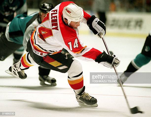 Calgary Flames forward Theoren Fleury shots the puck for his third goal during the third period of the NHL opening game in Tokyo 11 October Fleury...