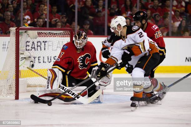 Calgary Flames Goalie Chad Johnson tracks the puck on the stick of against the Anaheim Ducks Winger Chris Wagner during game 4 of the first round of...