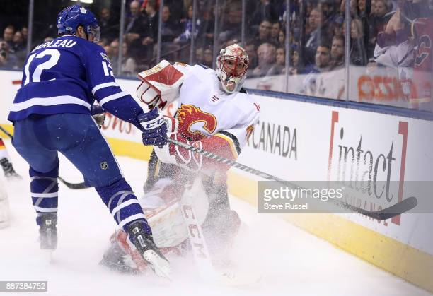 TORONTO ON DECEMBER 6 Calgary Flames goalie Mike Smith dumps the puck before Toronto Maple Leafs center Patrick Marleau reaches him as the Toronto...