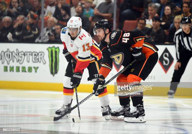 Calgary Flames Left Wing Johnny Gaudreau and Anaheim Ducks Winger Logan Shaw set up for a face off during an NHL game between the Calgary Flames and...