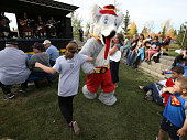 Calgary Flames mascot Harvey the Hound dances during the pregame festivities prior to the Calgary Flames playing the Arizona Coyotes in NHL Kraft...