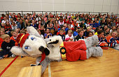 Calgary Flames mascot Harvey the Hound with a group of students during Day 4 of NHL Kraft Hockeyville at Fox Run School on September 24 2014 in...