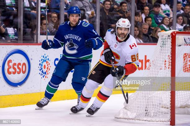 Calgary Flames Right Wing Jaromir Jagr and Vancouver Canucks Defenceman Derrick Pouliot skate behind the net during their NHL game at Rogers Arena on...
