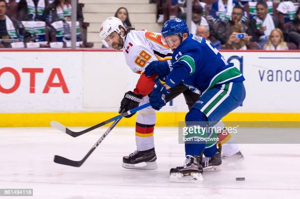 Calgary Flames Right Wing Jaromir Jagr and Vancouver Canucks Defenceman Troy Stecher battle for the puck during their NHL game at Rogers Arena on...