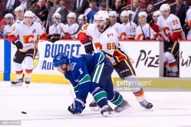 Calgary Flames Right Wing Jaromir Jagr collides with Vancouver Canucks Defenceman Derrick Pouliot during their NHL game at Rogers Arena on October 14...