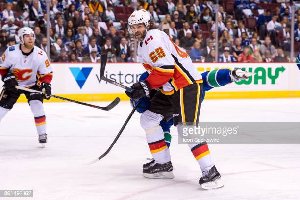 Calgary Flames Right Wing Jaromir Jagr collides with Vancouver Canucks Defenceman Troy Stecher during their NHL game at Rogers Arena on October 14...