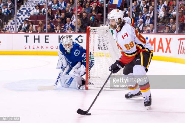 Calgary Flames Right Wing Jaromir Jagr looks to pass with Vancouver Canucks Goalie Jacob Markstrom in net during their NHL game at Rogers Arena on...