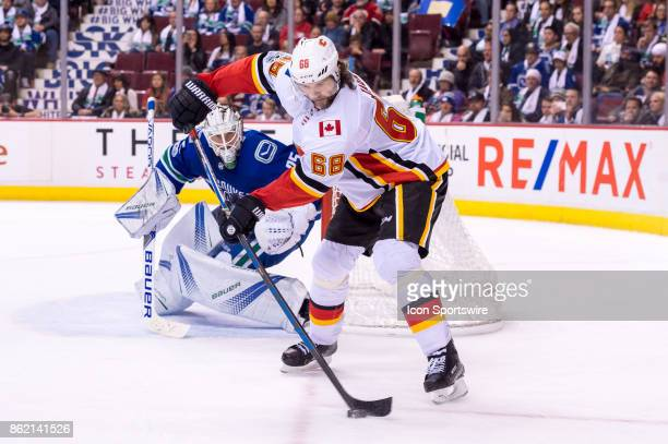 Calgary Flames Right Wing Jaromir Jagr takes a pass to the left of Vancouver Canucks Goalie Jacob Markstrom during their NHL game at Rogers Arena on...