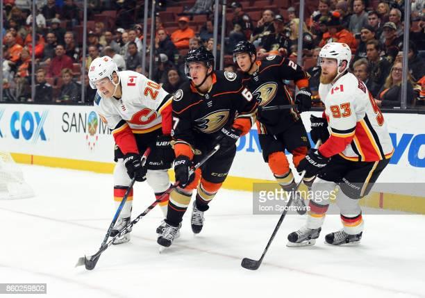 Calgary Flames Winger Curtis Lazar Anaheim Ducks Center Rickard Rakell and Calgary Flames Center Sam Bennett battle for position in the corner during...