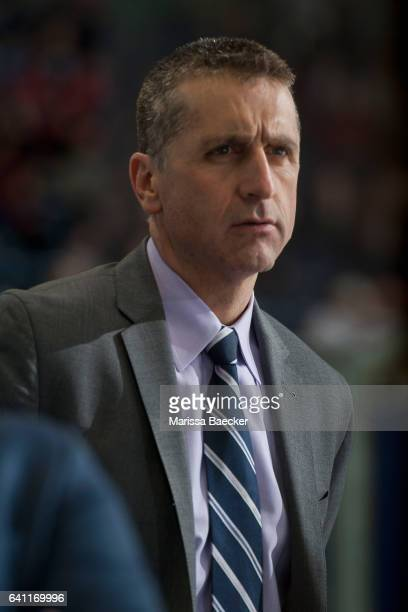 Calgary Hitmen head coach Mark French stands on the bench against the Kelowna Rockets on February 1 2017 at Prospera Place in Kelowna British...