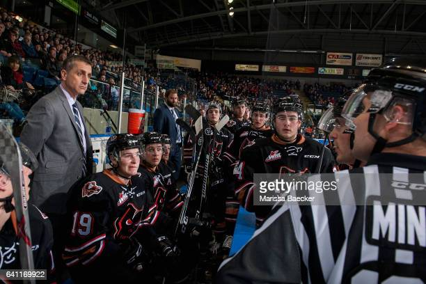 Calgary Hitmen head coach Mark French stands on the bench and speaks to ice officials at the Kelowna Rockets on February 1 2017 at Prospera Place in...