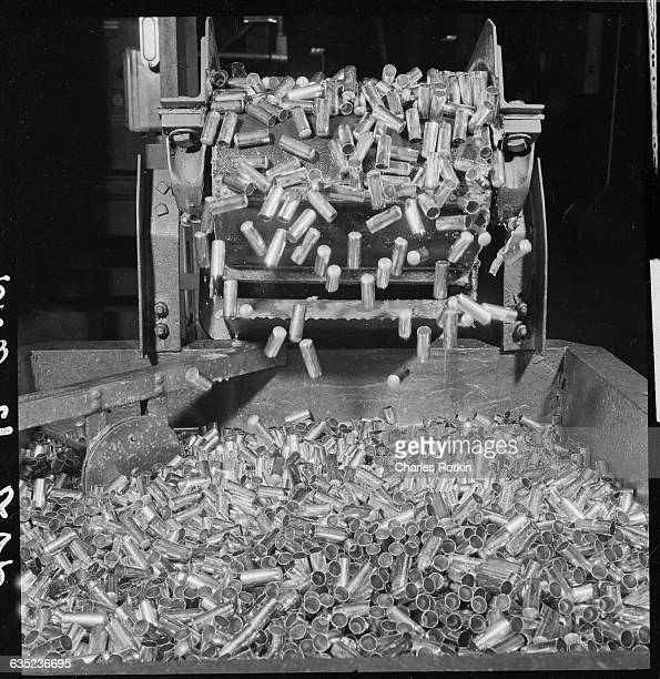 30 caliber cartridge casings coming off a conveyor belt at the St Louis Ordnance Works plant