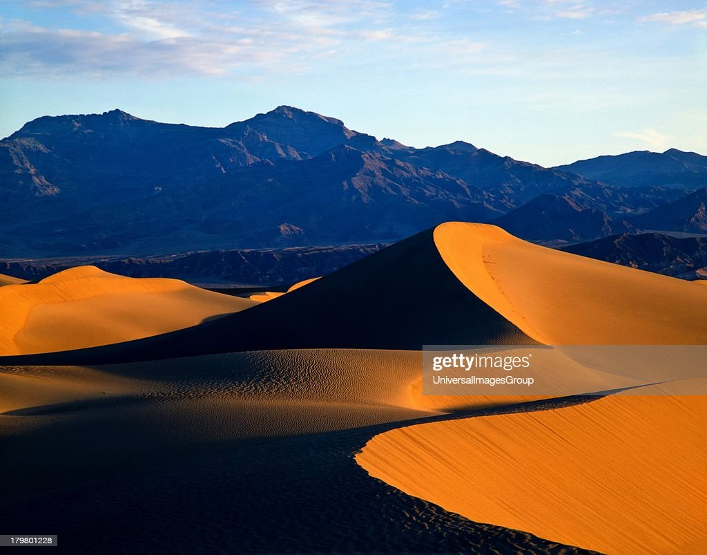 California and Nevada, Death Valley National Park, Sand Dunes in Mesquite Flat, and Cottonwood Mountains in the background.