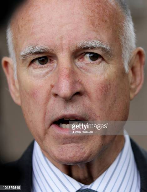 California Attorney General and democratic candidate for governor Jerry Brown talks with reporters after voting June 8 2010 in Oakland California...