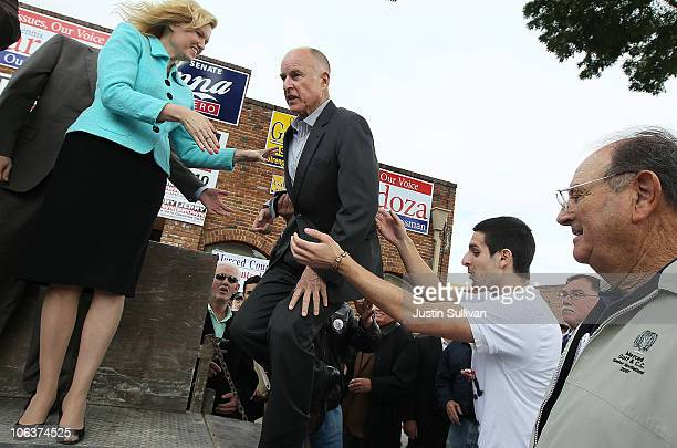 California Attorney General and Democratic gubernatorial candidate Jerry Brown stumbles as he walks onto a stahe before speaking to supporters during...