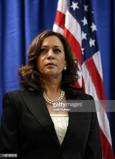 California Attorney General Kamala Harris looks on after California Governor Jerry Brown signed the California Homeowner Bill of Rights on July 11...