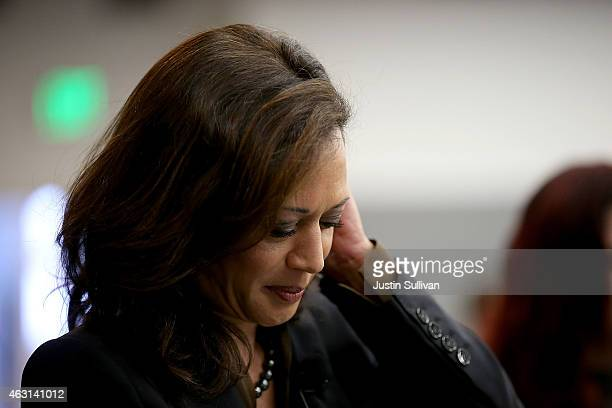 California Attorney General Kamala Harris looks over notes before delivering a speech during a Safer Internet Day event at Facebook headquarters on...