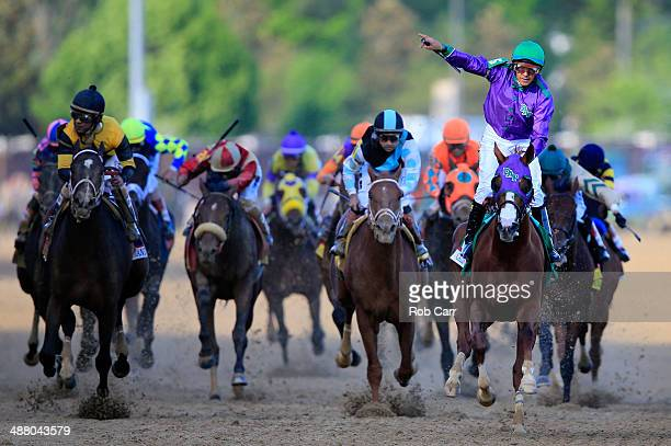 California Chrome ridden by Victor Espinoza crosses the finish line to win the 140th running of the Kentucky Derby at Churchill Downs on May 3 2014...