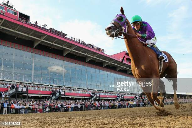 California Chrome ridden by Victor Espinoza races to the finish line enroute to winning the 139th running of the Preakness Stakes at Pimlico Race...