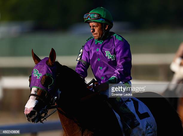 California Chrome ridden by Victor Espinoza walks down the track after losing the 146th running of the Belmont Stakes at Belmont Park on June 7 2014...
