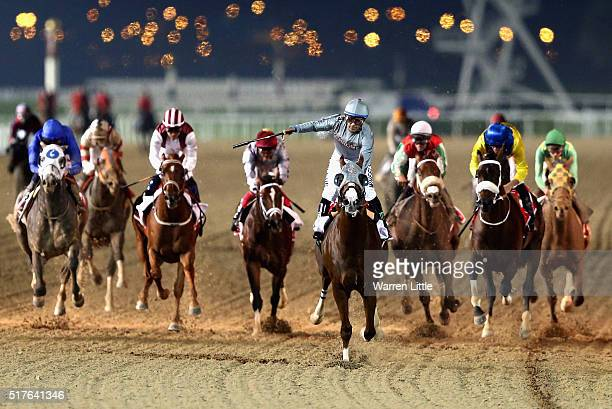 California Chrome ridden by Victor Espinoza wins the Dubai World Cup Sponsored By Emirates Airline as part of the duirng the Dubai World Cup at the...