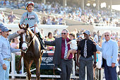 California Chrome trainer Art Sherman and assistant trainer Alan Sherman with jockey Victor Espinoza after winning San Diego Handicap on July 23 2016...