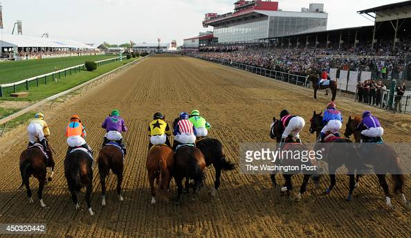 California Chrome with jockey Victor Espinoza breaks out of the starting gate and wins the 139th running of the Preakness Stakes at Pimlico Race...