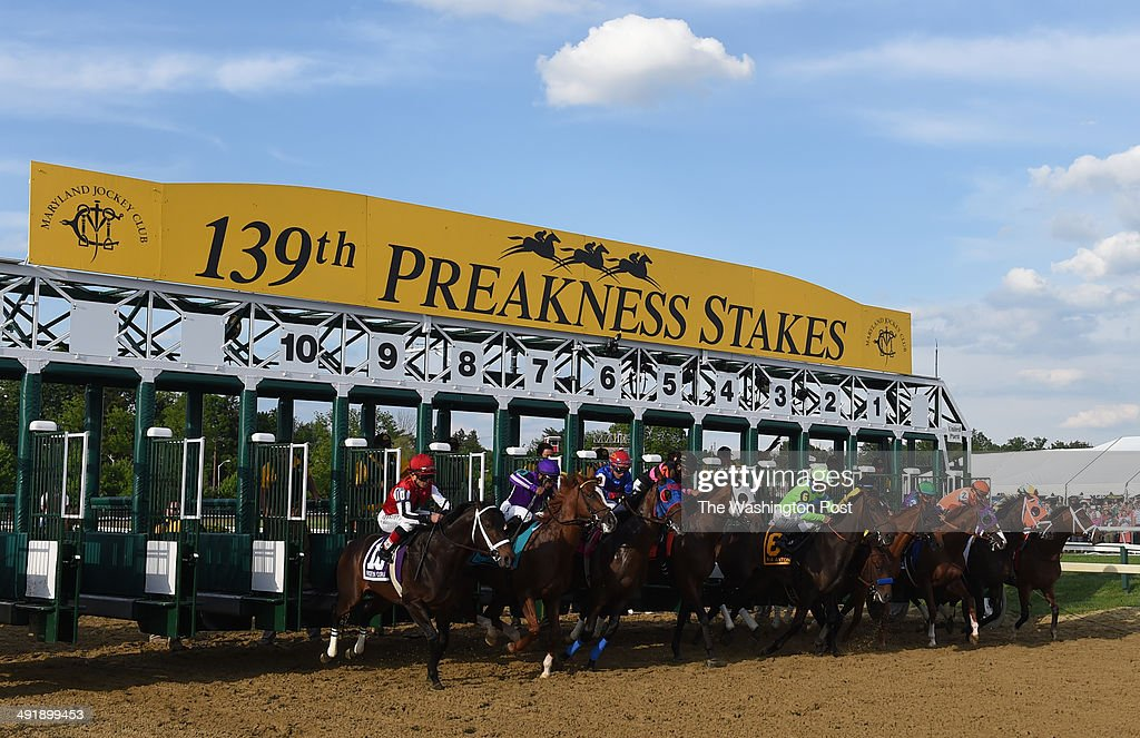 California Chrome with jockey Victor Espinoza wins the 139th running of the Preakness Stakes at Pimlico Race Course on May 17 2014 in Baltimore MD