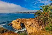 Rocky coastline with sea cave at La Jolla, California