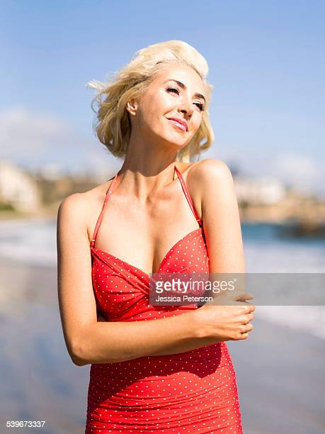 USA, California, Costa Mesa, Portrait of blond woman on beach