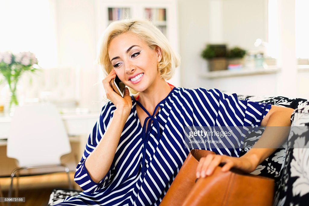 USA, California, Costa Mesa, Woman Using Phone In Living Room : Stock Photo Part 66