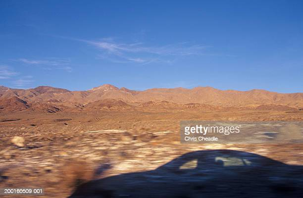 USA, California, Death Valley National Park, shadow of car on ground