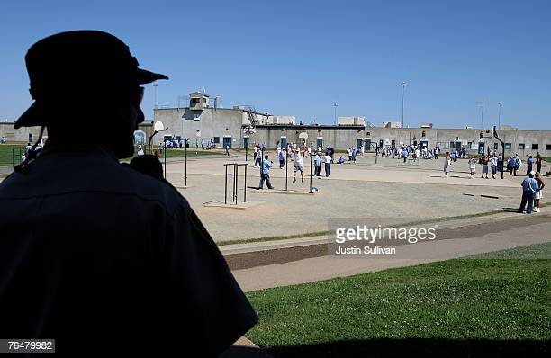 California Department of Corrections officer looks on as inmates at the Mule Creek State Prison exercise in the yard August 28 2007 in Ione...
