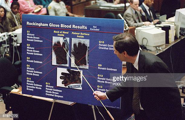 California Department Of Justice DNA lab scientist Gary Sims points to the blood spots found on the leather glove at OJ Simpson's Rockingham estate...
