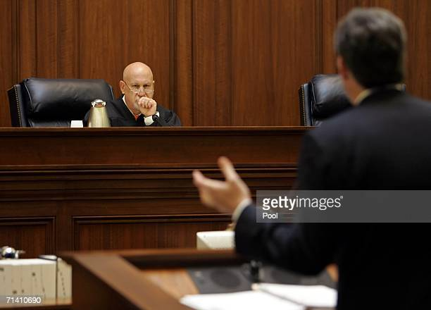 California Deputy Attorney General Christopher Krueger answers questions from Presiding Justice J Anthony Kline during a hearig of the First District...